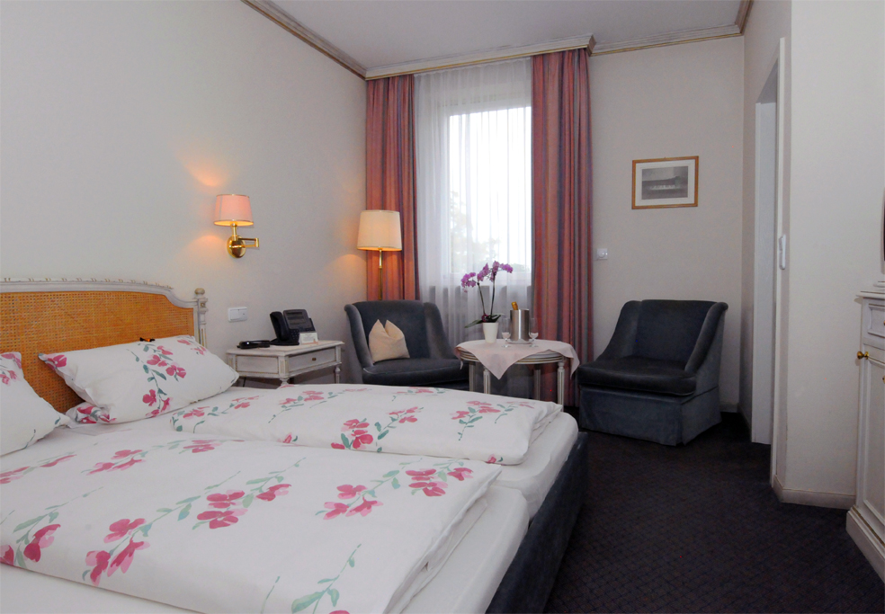 Double room with seating and a beautiful view of the Judenwiese; Non smoking rooms from